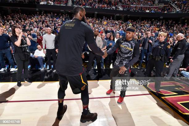 LeBron James and Isaiah Thomas of the Cleveland Cavaliers exchange high fives during the game against the Golden State Warriors on January 15 2018 at...