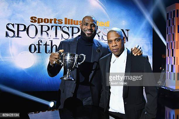LeBron James and Jay Z pose onstage with an award during the Sports Illustrated Sportsperson of the Year Ceremony 2016 at Barclays Center of Brooklyn...
