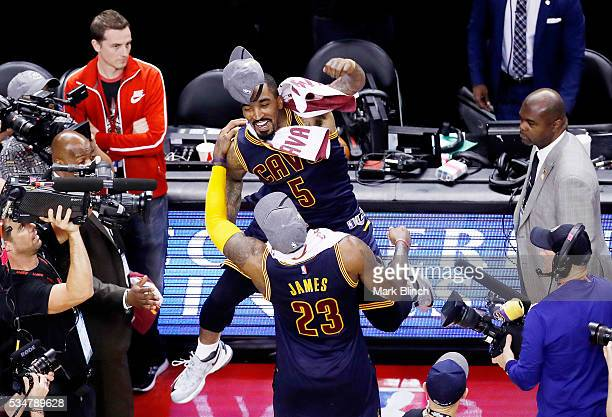 LeBron James and JR Smith of the Cleveland Cavaliers celebrate their 113 to 87 win over the Toronto Raptors in game six of the Eastern Conference...