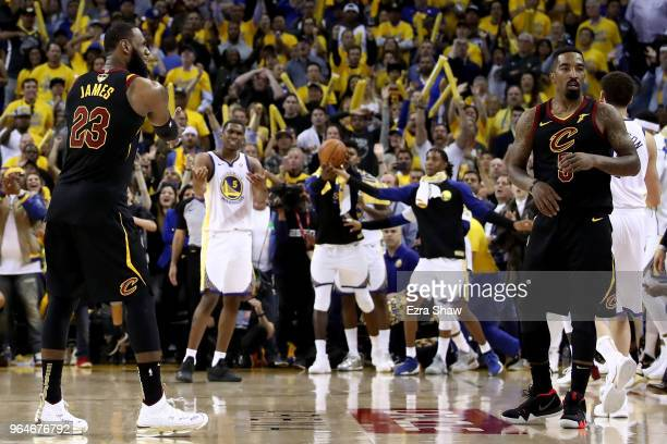 LeBron James and JR Smith of the Cleveland Cavaliers react as time expries in regulation against the Golden State Warriors in Game 1 of the 2018 NBA...