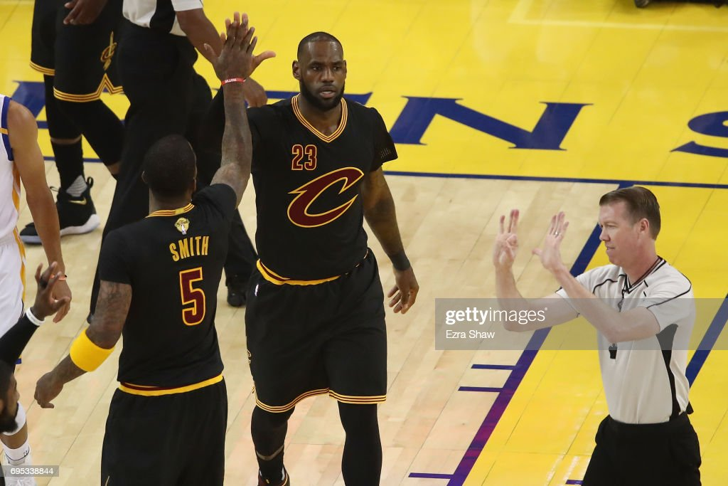 LeBron James #23 and JR Smith #5 of the Cleveland Cavaliers react to a play in Game 5 of the 2017 NBA Finals against the Golden State Warriors at ORACLE Arena on June 12, 2017 in Oakland, California.