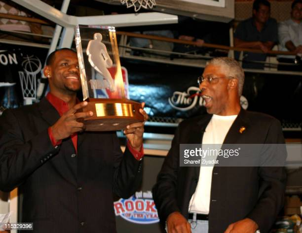 Lebron James and Julius Erving during Got Milk NBA Rookie Of The Year 2004 Presented to LeBron James at NBA Store in New York City New York United...