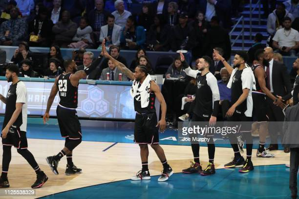 LeBron James and Kawhi Leonard of Team Lebron celebrate during the 2019 NBA AllStar Game on February 17 2019 at the Spectrum Center in Charlotte...