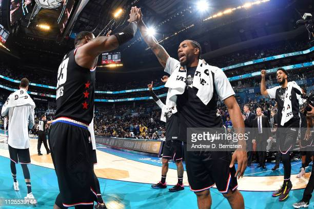 LeBron James and Kawhi Leonard of Team LeBron high five after the 2019 NBA AllStar Game on February 17 2019 at the Spectrum Center in Charlotte North...