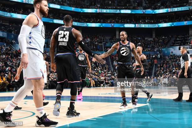 LeBron James and Kawhi Leonard of Team LeBron high five during the game against Team Giannis during the 2019 NBA AllStar Game on February 17 2019 at...