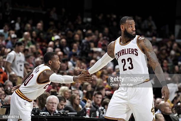 LeBron James and Kay Felder of the Cleveland Cavaliers shake hands during the game against the New Orleans Pelicans on January 2 2017 at Quicken...