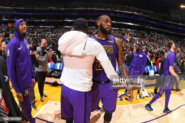 LeBron James and Kentavious CaldwellPope of the Los Angeles Lakers shake hands after the game against the Portland Trail Blazers on November 14 2018...