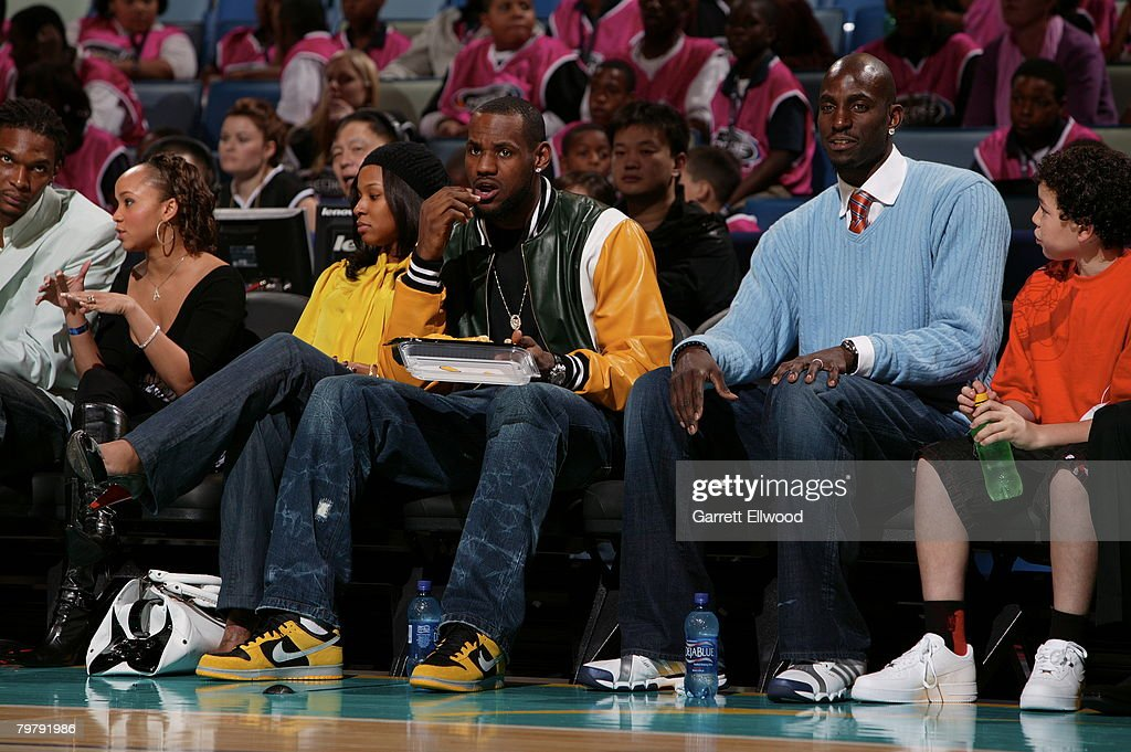 ac50eb2b9d20 LeBron James and Kevin Garnett take in the game during the 2008 ...