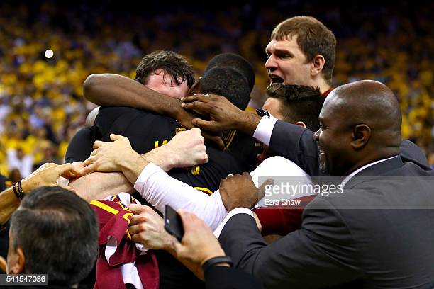 LeBron James and Kevin Love and the Cleveland Cavaliers celebrate after  defeating the Golden State Warriors d70ef092b
