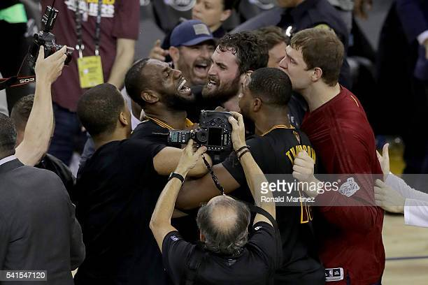 LeBron James and Kevin Love and the Cleveland Cavaliers celebrate after defeating the Golden State Warriors 9389 in Game 7 of the 2016 NBA Finals at...
