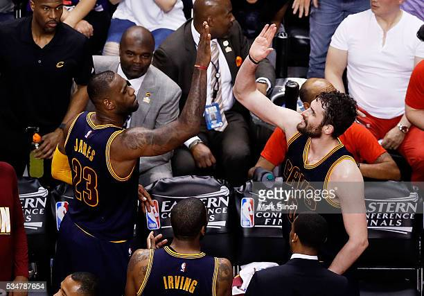 LeBron James and Kevin Love of the Cleveland Cavaliers celebrate late in their 113 to 87 win over the Toronto Raptors in game six of the Eastern...