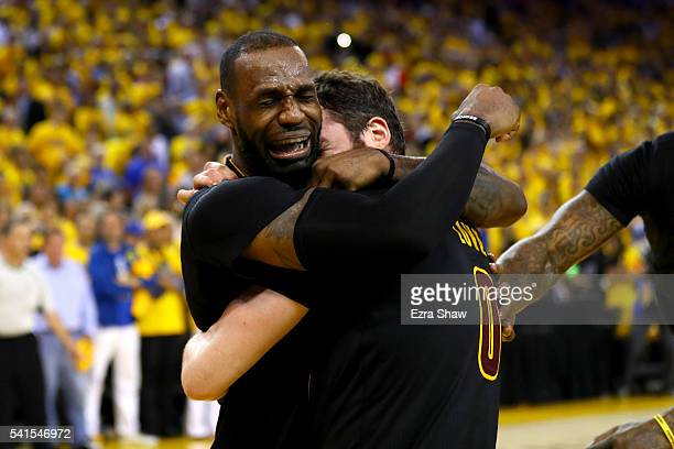 LeBron James and Kevin Love of the Cleveland Cavaliers celebrate after  defeating the Golden State Warriors 09b2805b6