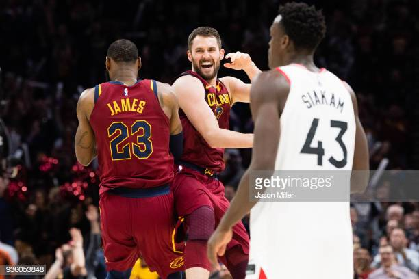 LeBron James and Kevin Love of the Cleveland Cavaliers celebrate after scoring against the Toronto Raptors during the second half at Quicken Loans...