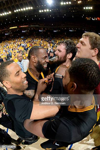 LeBron James and Kevin Love of the Cleveland Cavaliers celebrate with their teammates after winning Game Seven of the 2016 NBA Finals against the...