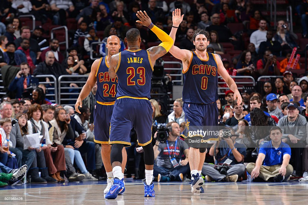 LeBron James #23 and Kevin Love #0 of the Cleveland Cavaliers high five during the game against the Philadelphia 76ers at the Wells Fargo Center on January 10, 2016 in Philadelphia, Pennsylvania.