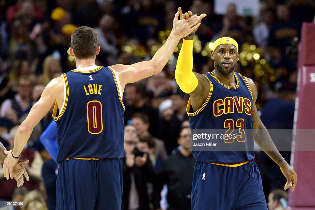 LeBron James #23 and Kevin Love #0 of the Cleveland Cavaliers react after a play in the first quarter at Quicken Loans Arena on October 30, 2014 in Cleveland, Ohio.