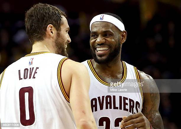 LeBron James and Kevin Love of the Cleveland Cavaliers react after a play in the second half against the Minnesota Timberwolves at Quicken Loans...