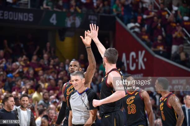 LeBron James and Kevin Love of the Cleveland Cavaliers react during game against the Boston Celtics during Game Four of the Eastern Conference Finals...