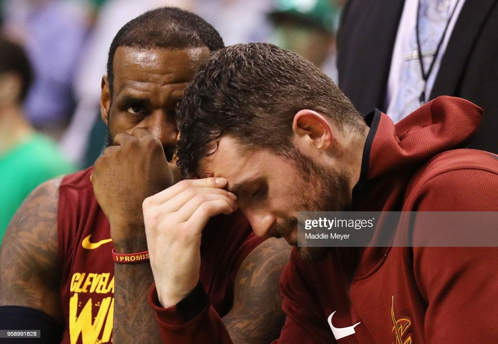 LeBron James #23 and Kevin Love #0 of the Cleveland Cavaliers react on the bench in the second half against the Boston Celtics during Game Two of the 2018 NBA Eastern Conference Finals at TD Garden on May 15, 2018 in Boston, Massachusetts.
