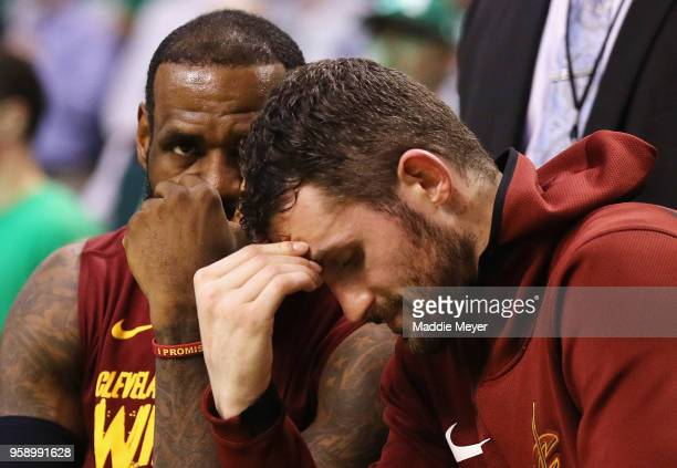 LeBron James and Kevin Love of the Cleveland Cavaliers react on the bench in the second half against the Boston Celtics during Game Two of the 2018...