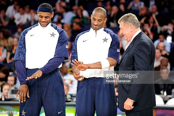 LeBron James and Kobe Bryant members of the gold medal winning USA Olympic basketball team admire their rings as USA Basketball president Jerry...