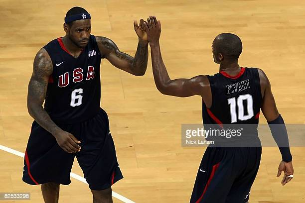 LeBron James and Kobe Bryant of the United States celebrate in the fourth quarter of the gold medal game against Spain during Day 16 of the Beijing...