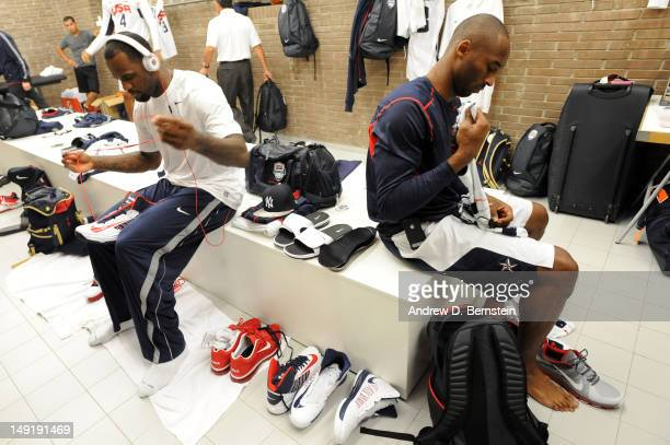 LeBron James and Kobe Bryant of the US Men's Senior National Team get ready in the locker room prior to a game against the Spanish Men's Senior...