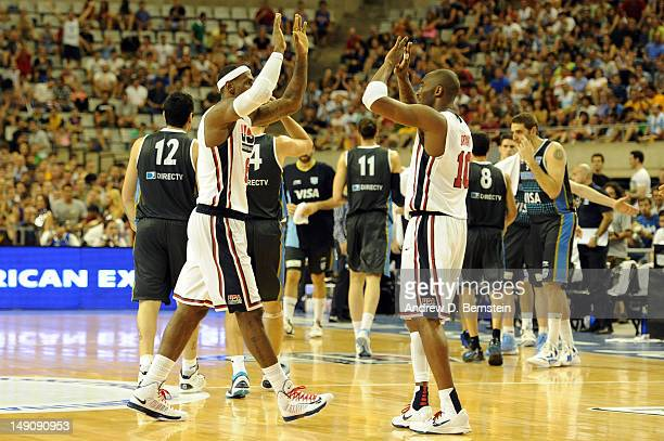 Lebron James and Kobe Bryant of the US Men's Senior National Team high five on the court after a game against the Argentinean Men's Senior National...