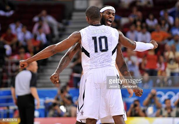 LeBron James and Kobe Bryant of the US Men's Senior National Team celebrate against Greece during a men's preliminary basketball game at the 2008...