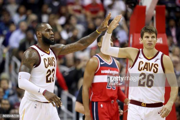 LeBron James and Kyle Korver of the Cleveland Cavaliers celebrate following their 130122 win over the Washington Wizards at Capital One Arena on...