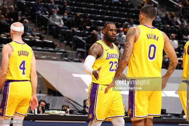 LeBron James and Kyle Kuzma of the Los Angeles Lakers hi-five during the game against the Utah Jazz on February 24, 2021 at vivint.SmartHome Arena in...