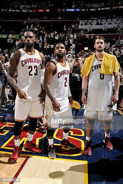 LeBron James and Kyrie Irving and Kevin Love of the Cleveland Cavaliers are seen after the game against the Detroit Pistons in Game One of the...