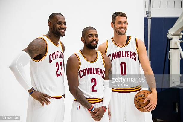 LeBron James and Kyrie Irving and Kevin Love of the Cleveland Cavaliers pose for a portrait during media day at Cleveland Clinic Courts on September...