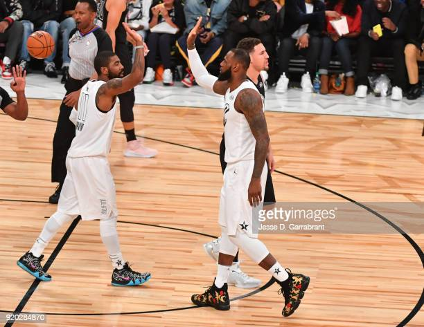 LeBron James and Kyrie Irving of Team LeBron give each other high fives against Team Curry during the NBA AllStar Game as a part of 2018 NBA AllStar...