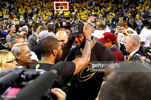 LeBron James and Kyrie Irving of the Cleveland Cavaliers celebrate after defeating the Golden State Warriors 9389 in Game 7 of the 2016 NBA Finals at...