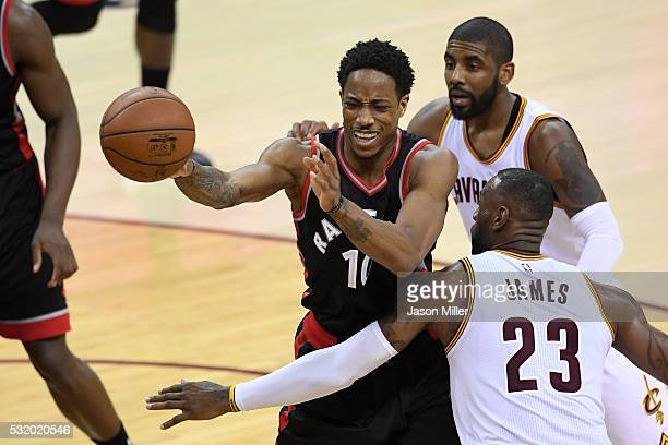 LeBron James and Kyrie Irving of the Cleveland Cavaliers defend DeMar DeRozan of the Toronto Raptors in the second half in game one of the Eastern...