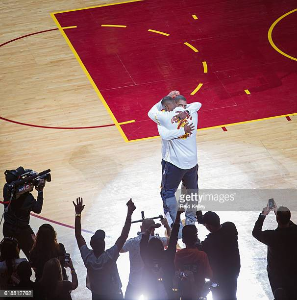 LeBron James and Kyrie Irving of the Cleveland Cavaliers hug before the game against the New York Knicks on October 25 2016 at Quicken Loans Arena in...