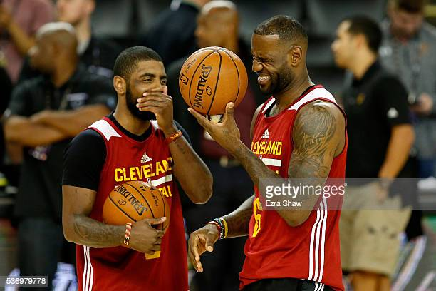 LeBron James and Kyrie Irving of the Cleveland Cavaliers laugh during a conversation at practice for the 2016 NBA Finals at ORACLE Arena on June 1...
