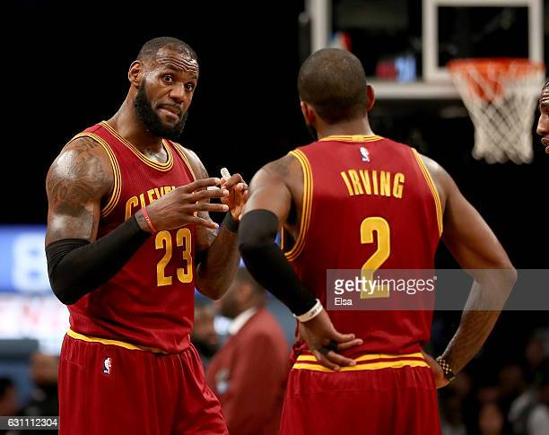 LeBron James and Kyrie Irving of the Cleveland Cavaliers talk during a time out against the Brooklyn Nets at the Barclays Center on January 6 2017 in...