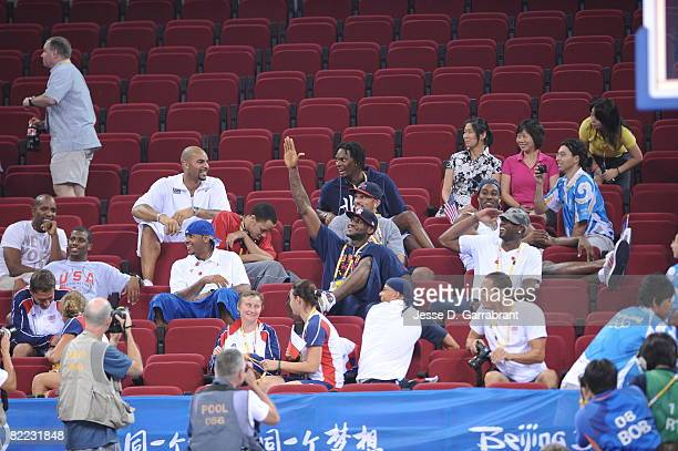 LeBron James and members of the U.S. Men's Senior National Team takes in the game of the U.S. Women's Senior National Team against the Czech Republic...