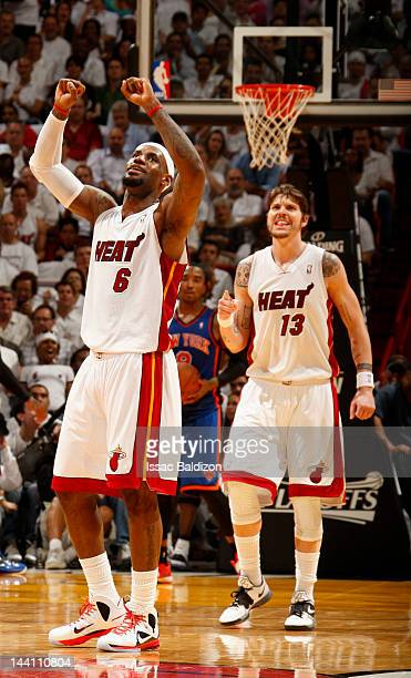 LeBron James and Mike Miller of the Miami Heat react to the game action in Game Five of the Eastern Conference Quarterfinals against the New York...