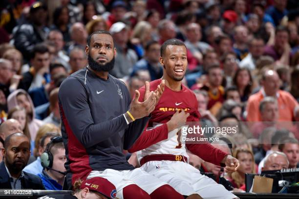 LeBron James and Rodney Hood of the Cleveland Cavaliers look on during the game against the Toronto Raptors on April 3 2018 at Quicken Loans Arena in...