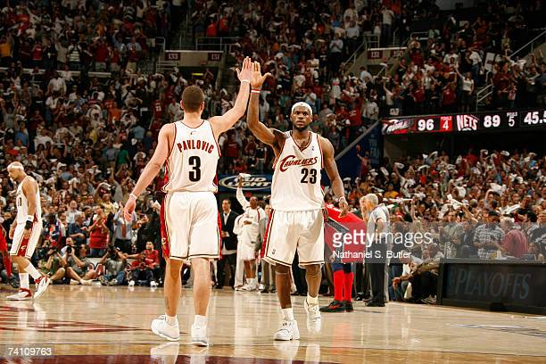 LeBron James and Sasha Pavlovic of the Cleveland Cavaliers celebrate against the New Jersey Nets in Game Two of the Eastern Conference Semifinals...