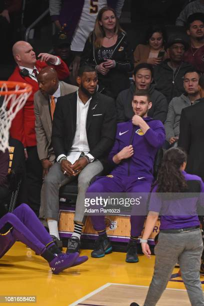 Lebron James and Sviatoslav Mykhailiuk of the Los Angeles Lakers look on from the bench during the game against the New York Knicks on January 4 2019...