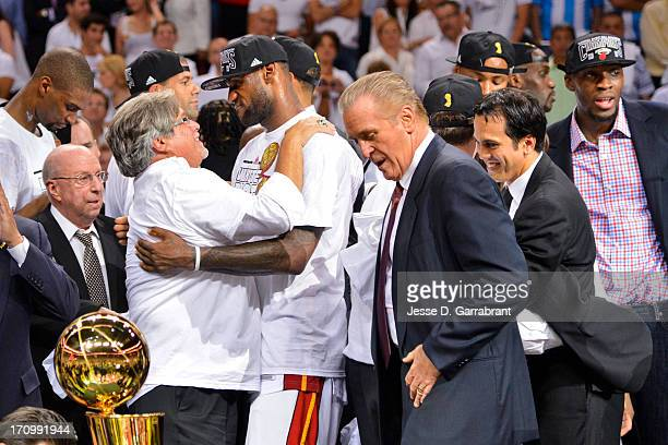 LeBron James and team owner Micky Arison of the Miami Heat celebrate following their team's victory against the San Antonio Spurs in Game Seven of...