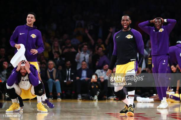 LeBron James and the Los Angeles Lakers bench react after a play by Lance Stephenson against the Washington Wizards during the first half at Staples...