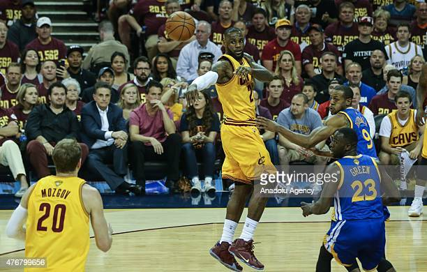 LeBron James and Timofey Mozgov of the Cleveland Cavaliers vie against Andre Iguodala of the Golden State Warriors during Game Four of the 2015 NBA...
