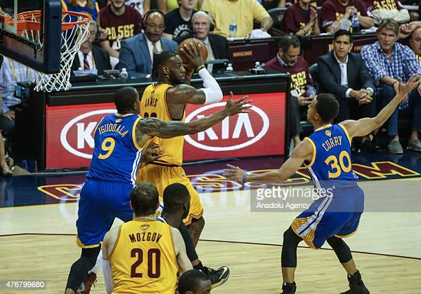 LeBron James and Timofey Mozgov of the Cleveland Cavaliers vie against Andre Iguodala and Stephen Curry of the Golden State Warriors during Game Four...