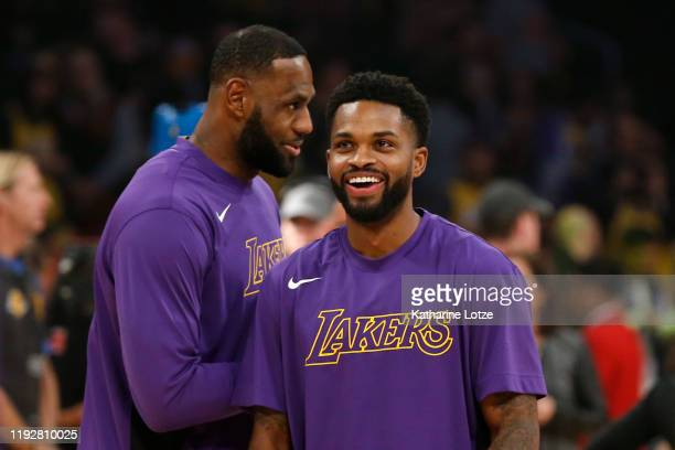 LeBron James and Troy Daniels of the Los Angeles Lakers talk during warm ups ahead of a game against the Minnesota Timberwolves with at Staples...