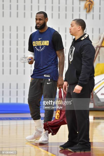 LeBron James and Tyronn Lue of the Cleveland Cavaliers look on during an allaccess practice at The Cleveland Clinic Courts on January 25 2018 in...